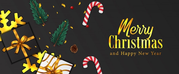 メリークリスマス、そしてハッピーニューイヤー。クリスマスバナー。金の紙吹雪、モミのトウヒの葉の花輪、安物の宝石、松ぼっくり、プレゼントボックス、キャンディー杖。