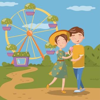 歩きながら抱いて愛のカップル、幸せな若い男と遊園地の図の観覧車の前で女性