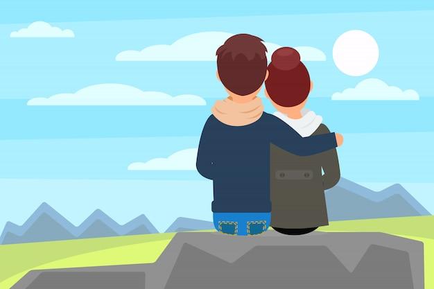 石の岩の上に座って、山の美しい自然の風景を楽しむ若いカップル。野外レクリエーション。背面図。平らな