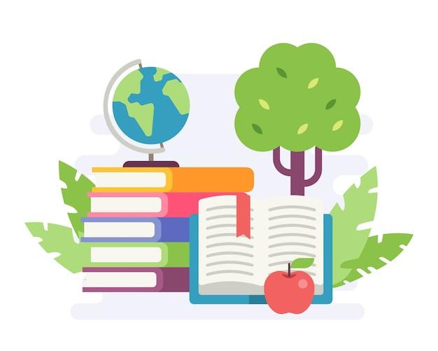 リンゴとミニ地球儀の本のスタック