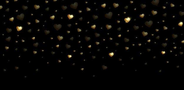 Красивые сердца конфеты золотого цвета на черном фоне. день святого валентина свадьба.