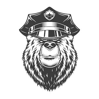 警察の帽子のモノクロの深刻なクマ