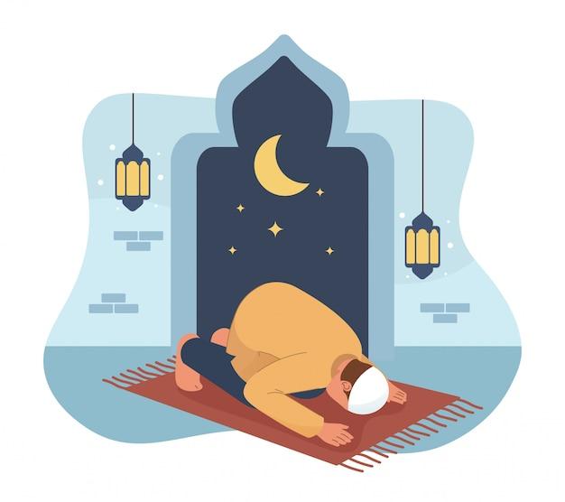 モスクで祈るイスラム教徒の男性