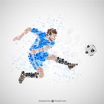 サッカーを蹴るサッカー選手