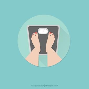 体重計の上に立って女性の足