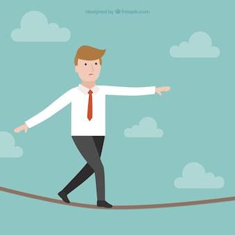 綱渡りの上を歩いビジネスマン
