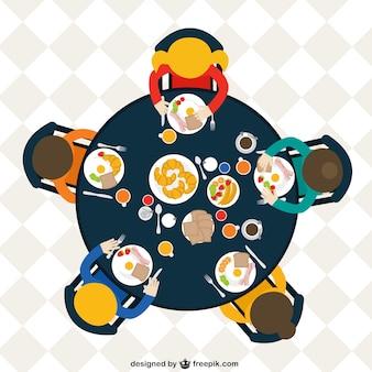 朝食を食べるテーブルで家族