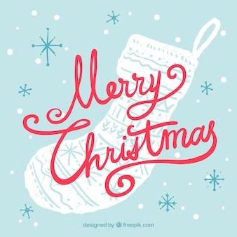 手書き文字とクリスマスの靴下の背景