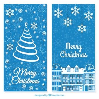 雪片青い背景上のクリスマスカード