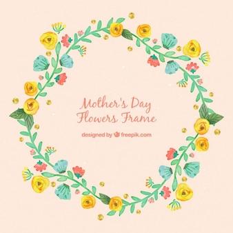 手が黄色のバラと花の花輪を描い