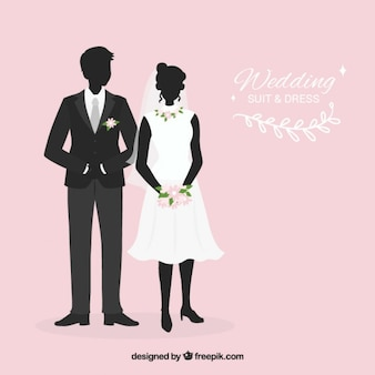結婚式のスーツと花嫁のドレスのシルエット