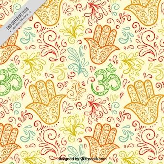 ファティマの手の背景に手描かれた着色された花飾り