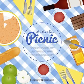 ピクニックの背景の布の完全な食品