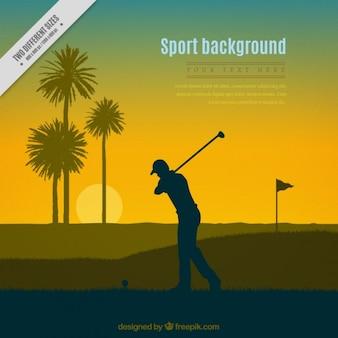 ゴルファーのシルエットのサンセットの背景