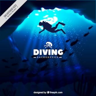 ダイバーのシルエットと深い海洋背景