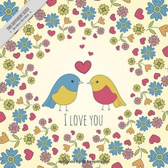 花と愛の鳥の背景で