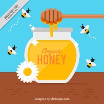 蜂蜜の瓶の背景の周りに蜂