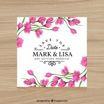 結婚式のためのピンクの花と招待状