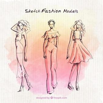 ファッションモデルは、水彩画の背景でスケッチ
