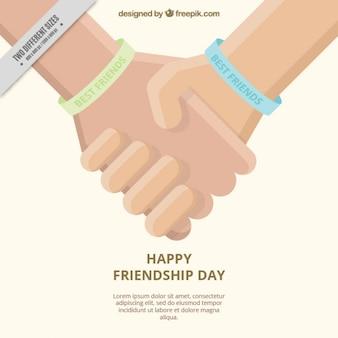 フラットなデザインで参加した手で友情の日の背景