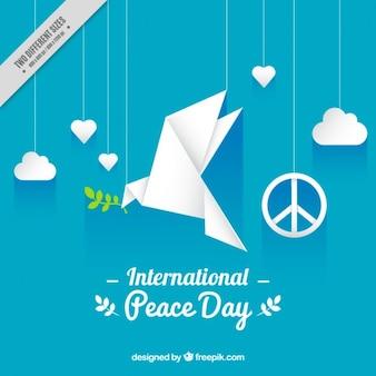 折り紙の平和鳩と青の背景