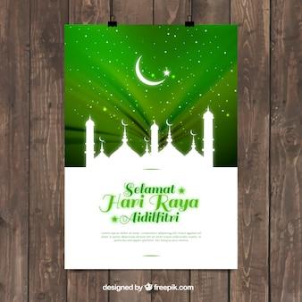 明るい緑の背景にモスクのシルエット