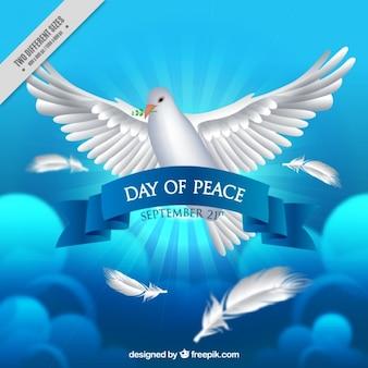青い背景の平和の日のための現実的な鳩