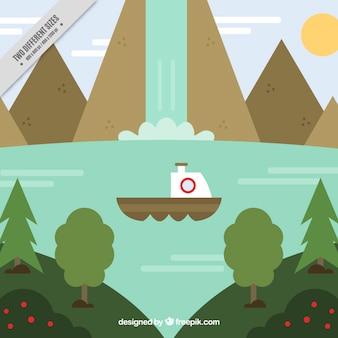 滝の背景を持つボートセーリング