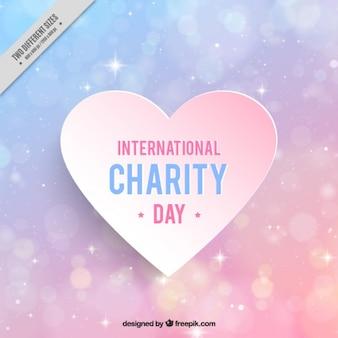 カラフルな背景以上の国際慈善日のハート