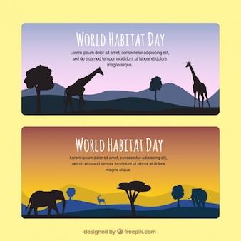 アフリカの動物と世界の生息地の一日の風景バナー
