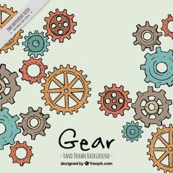 カラフルな歯車と手描きの背景