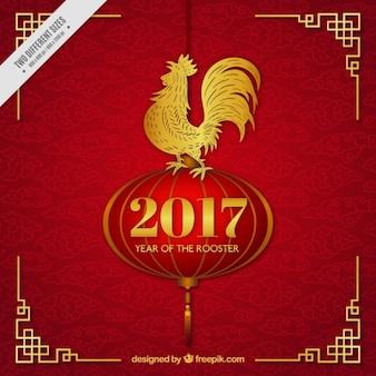赤と金色の中国の旧正月の雄鶏の背景