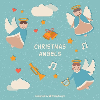 Фон из прекрасных рождественских ангелов и музыкальных инструментов