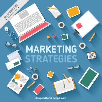 ビジネス文書やラップトップと青の背景