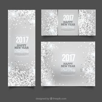 バナーと新年のパーティーの銀リーフレット