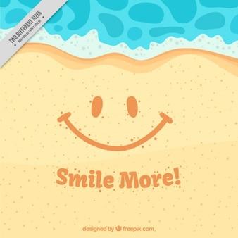 メッセージ「もっと笑顔」と砂の上に背景笑顔
