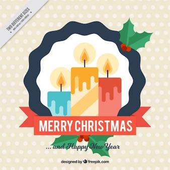 フラットなデザインのキャンドルとメリークリスマスの背景