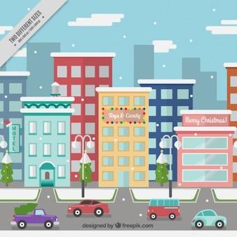 Город рождество со зданиями и автомобилями в плоской конструкции