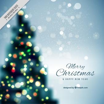 Расфокусированным фоне рождественской елки