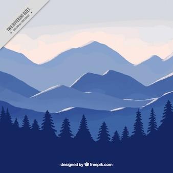 Синий пейзаж фон с гор и сосен