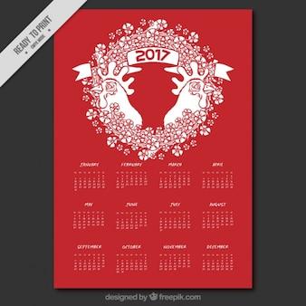 オンドリの年のための白と赤のカレンダー
