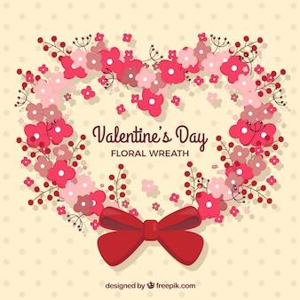 バレンタインデーのための赤いリボン付きフラット花の花輪