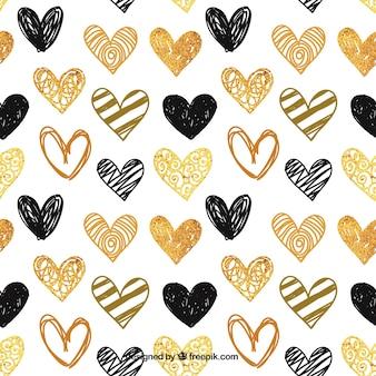 手描きの金色と黒の心のパターン