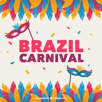 羽とマスクを持つブラジルのカーニバルの背景