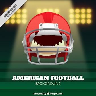 ヘルメットとリアルなアメリカンフットボールの背景