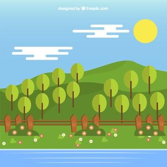 木々や川と緑の牧草地の風景