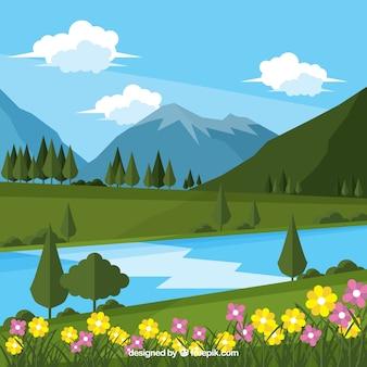 山のある風景の花の背景と川