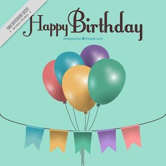 誕生日のためのカラフルな風船や花輪と背景