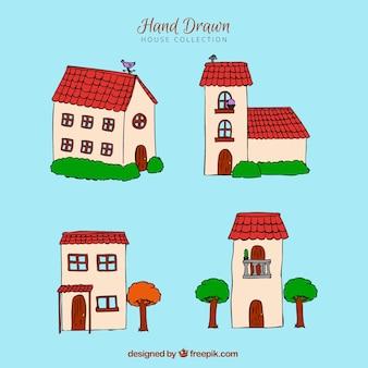 Коллекция из четырех рукописных домов с красными крышами
