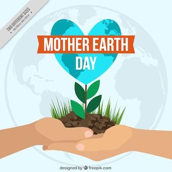 母なる地球の日のための植物と手の背景